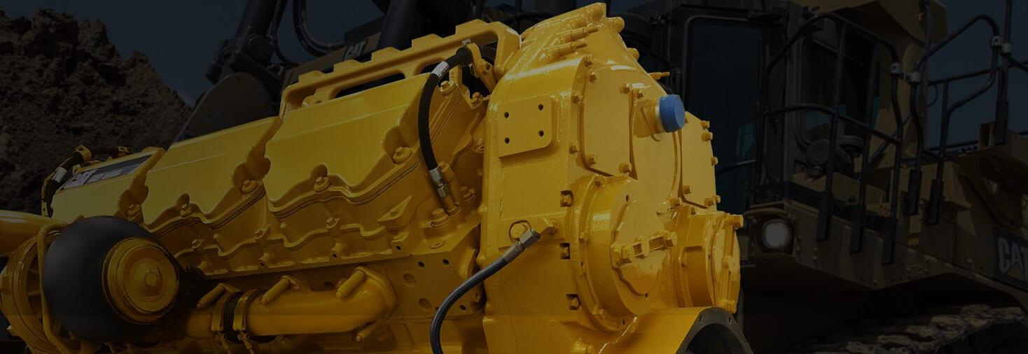 Remanufactured CAT Engine Header with Tractor Background